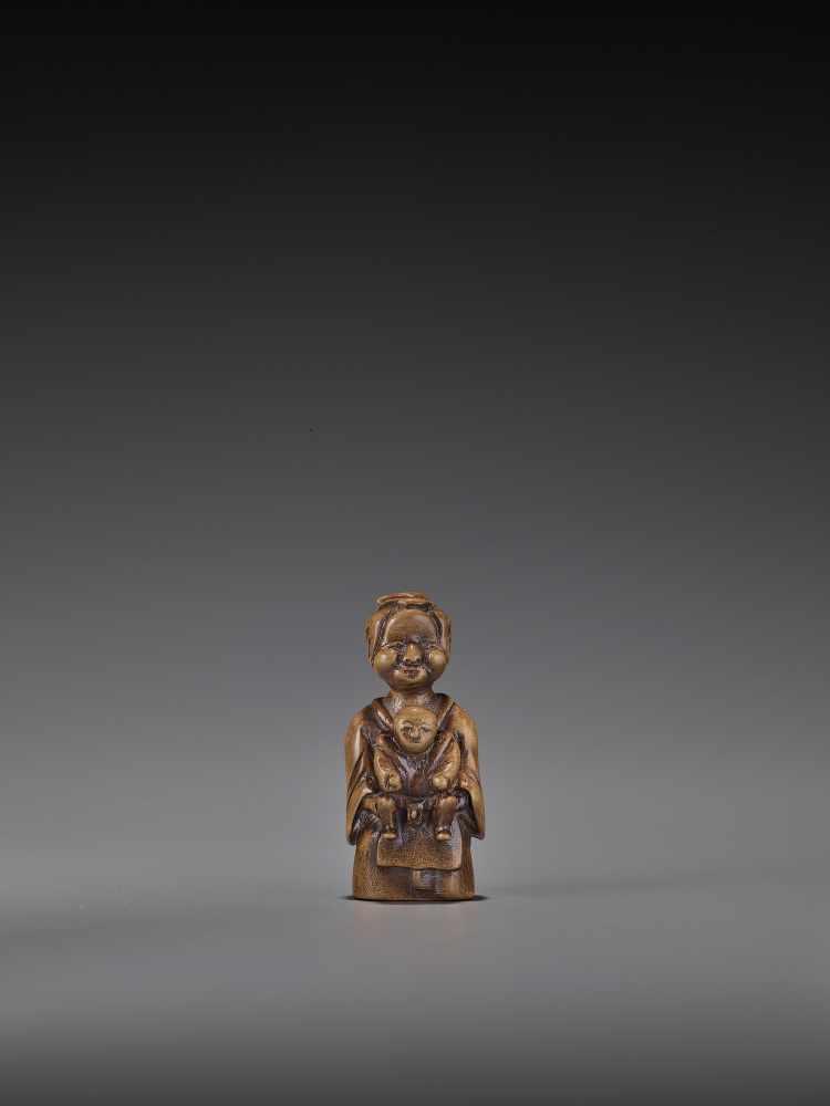 A RARE WOOD 'DOUBLE SHUNGA' NETSUKE OF A MOTHER AND CHILD UnsignedJapan, 18th century, Edo period (