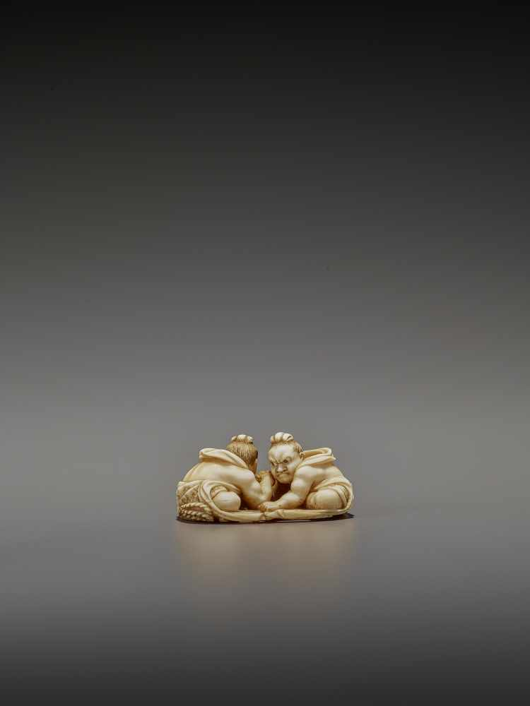 TOMOTAKA: AN IVORY NETSUKE OF TWO ARMWRESTLING NIO ON A WARAJI By Tomotaka, signed TomotakaJapan, - Image 5 of 11