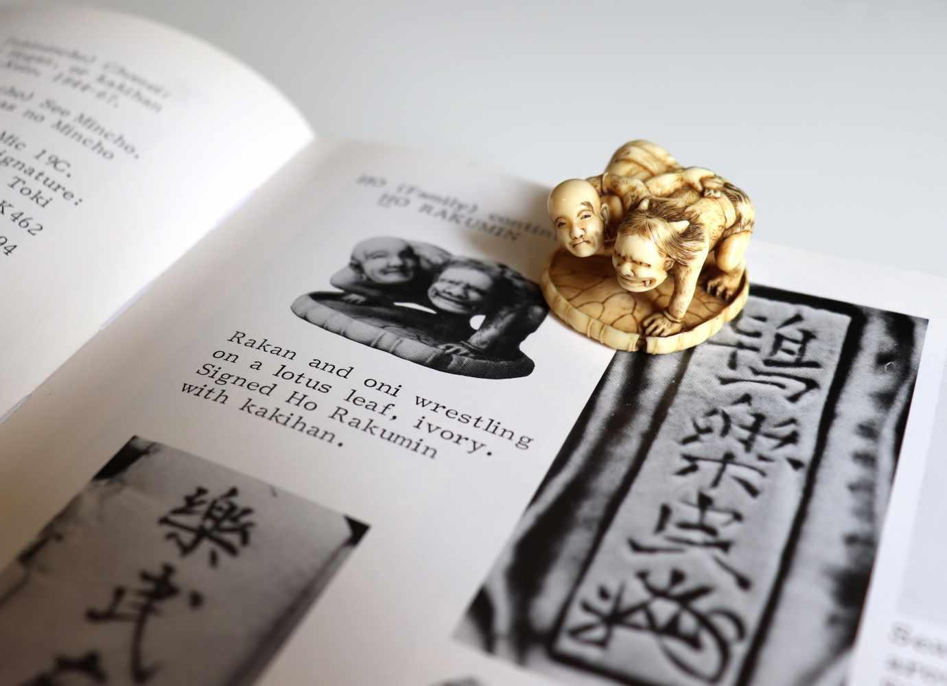 HO RAKUMIN: A FINE IVORY NETSUKE OF JIZO WRESTLING AN ONI By Ho Rakumin, signed Ho Rakumin with - Image 10 of 11