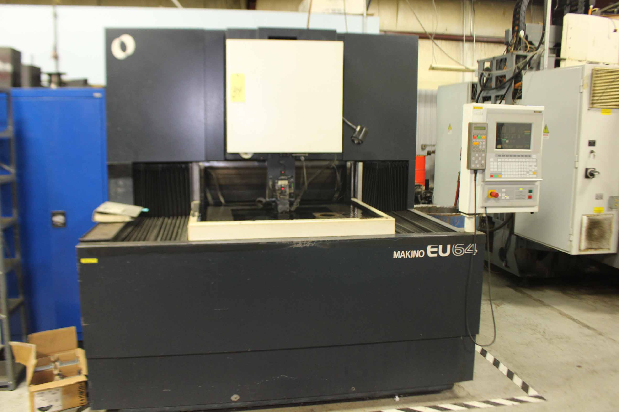 """Lot 34 - CNC WIRE EDM, MAKINO MDL. EU64 5-AXIS WIRE TYPE, MGW-N CNC control, 32.2"""" x 23.6"""" worktable, 37"""" x"""