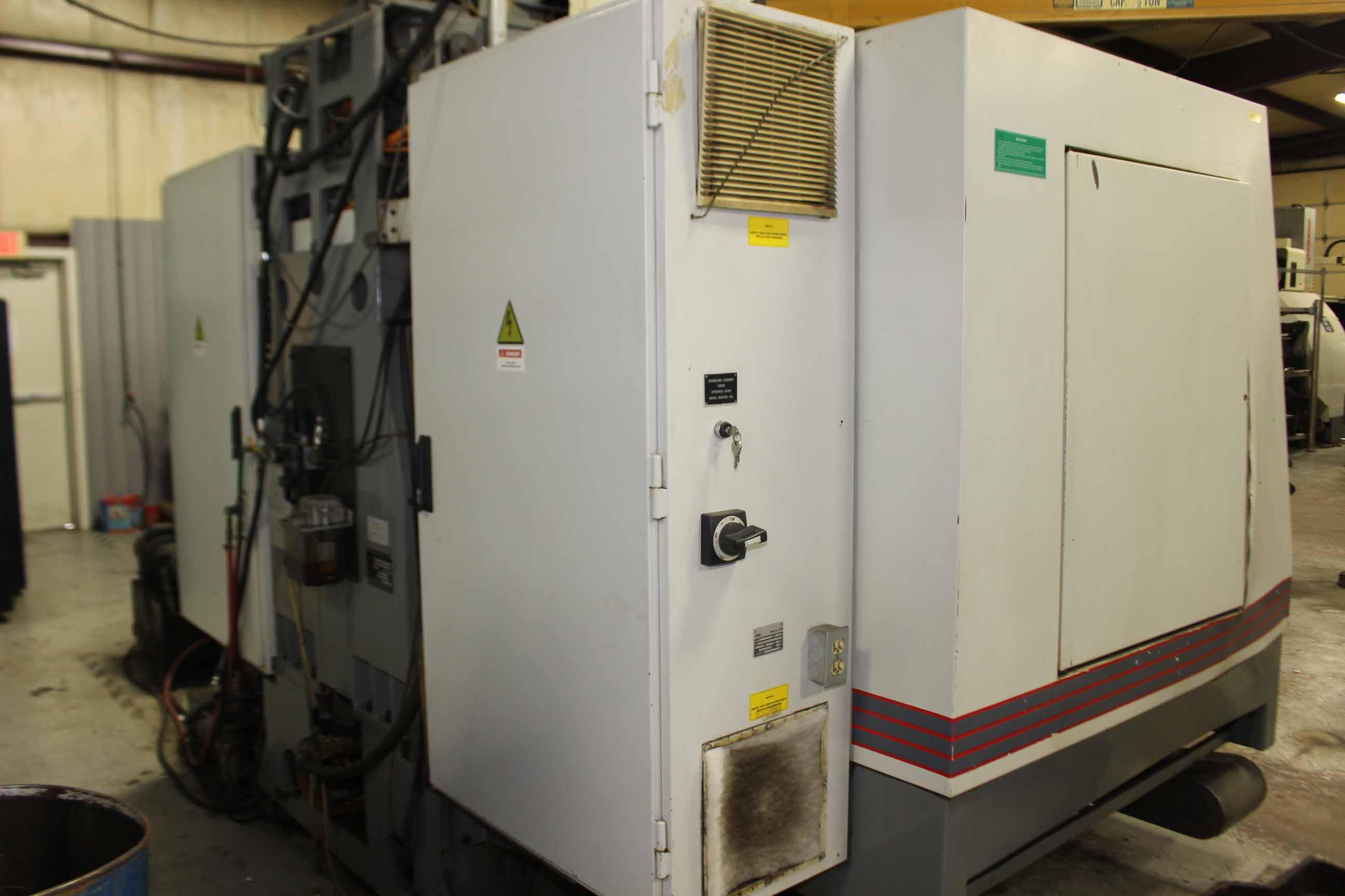 "Lot 31 - VERTICAL MACHINING CENTER, TREE MDL. VMC1260E, Yasnac MX2 CNC control, 57"" x 23-3/16"" table, 50"""