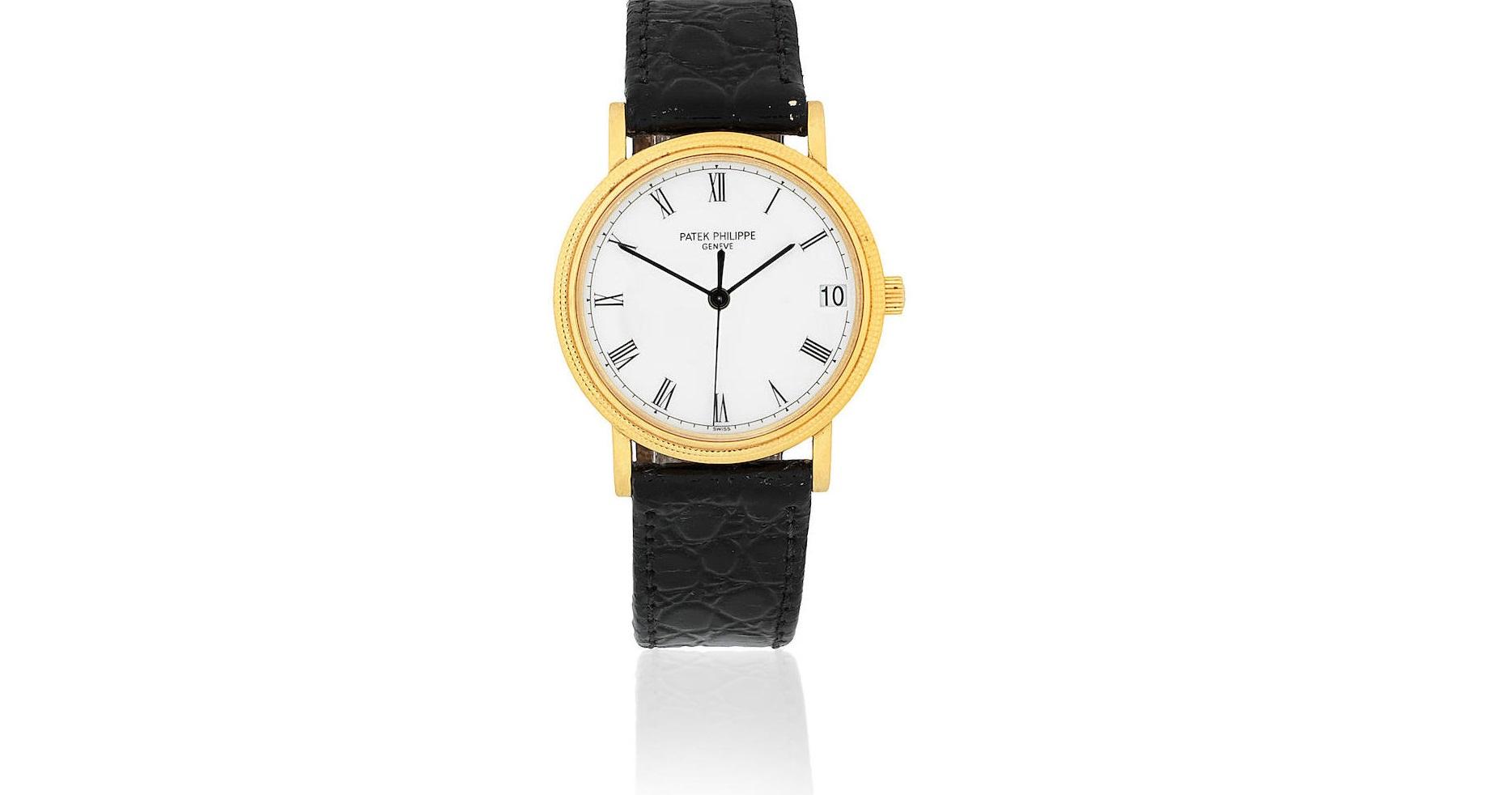 Lot 11 - Patek Philippe. An 18K gold automatic calendar wristwatch