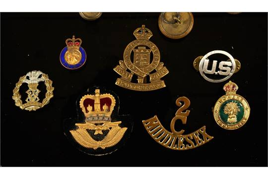 Military brass buttons, badges and shoulder titles and other
