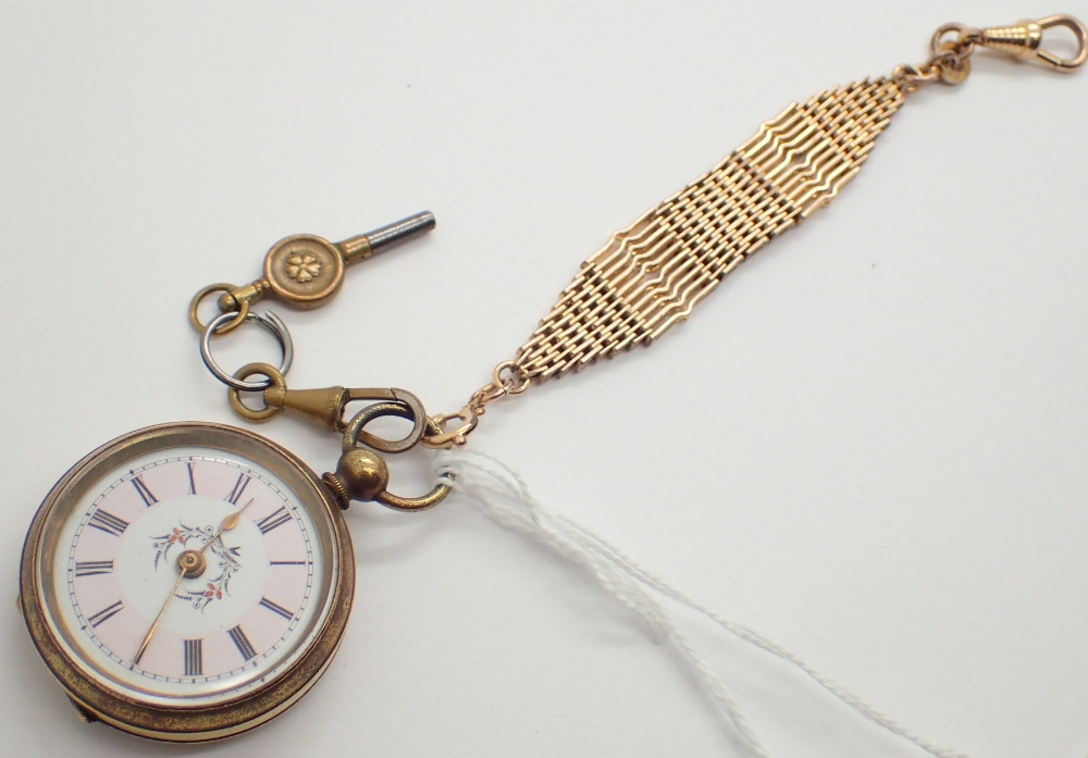 Yellow metal Victorian fob watch with key and chain CONDITION REPORT: This item was