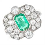 EMERALD AND DIAMOND CLUSTER RING, IN ART DECO DESIGN set with an emerald cut emerald in a cluster of