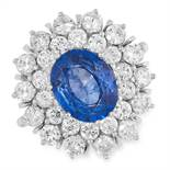 3.70 CARAT SAPPHIRE AND DIAMOND CLUSTER RING set with an oval cut sapphire of approximately 3.70