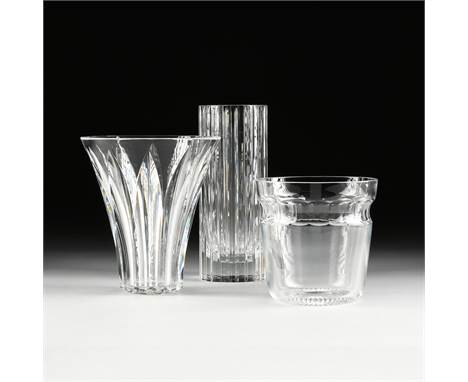 """TWO BACCARAT CRYSTAL VASES AND ONE CRYSTAL ICE BUCKET, LATE 20TH CENTURY, comprising a Baccarat cylindrical """"Harmony"""" vase wi"""