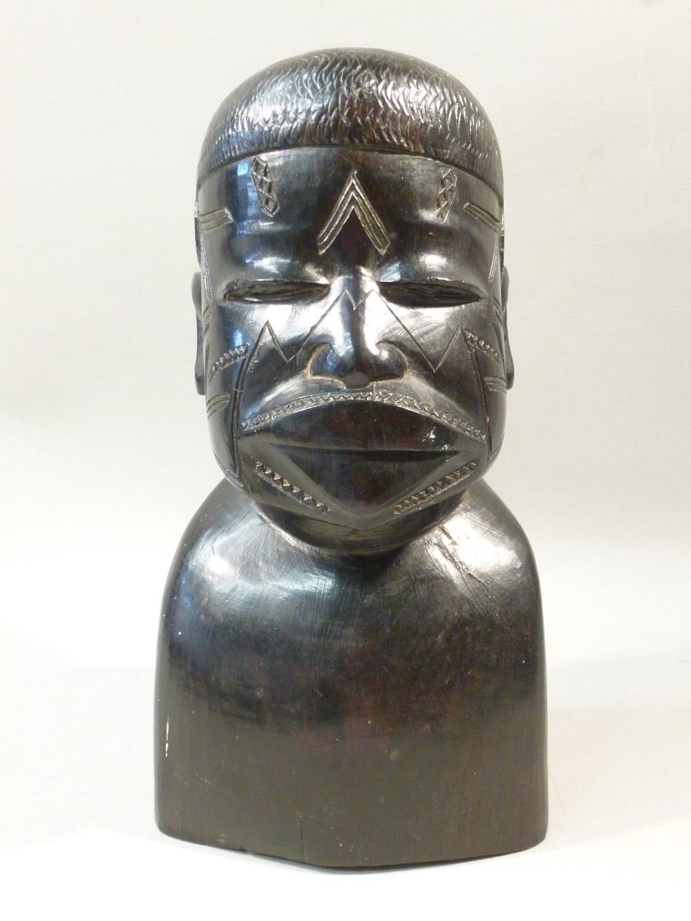 Ebony carved african tribal head h cm and stone