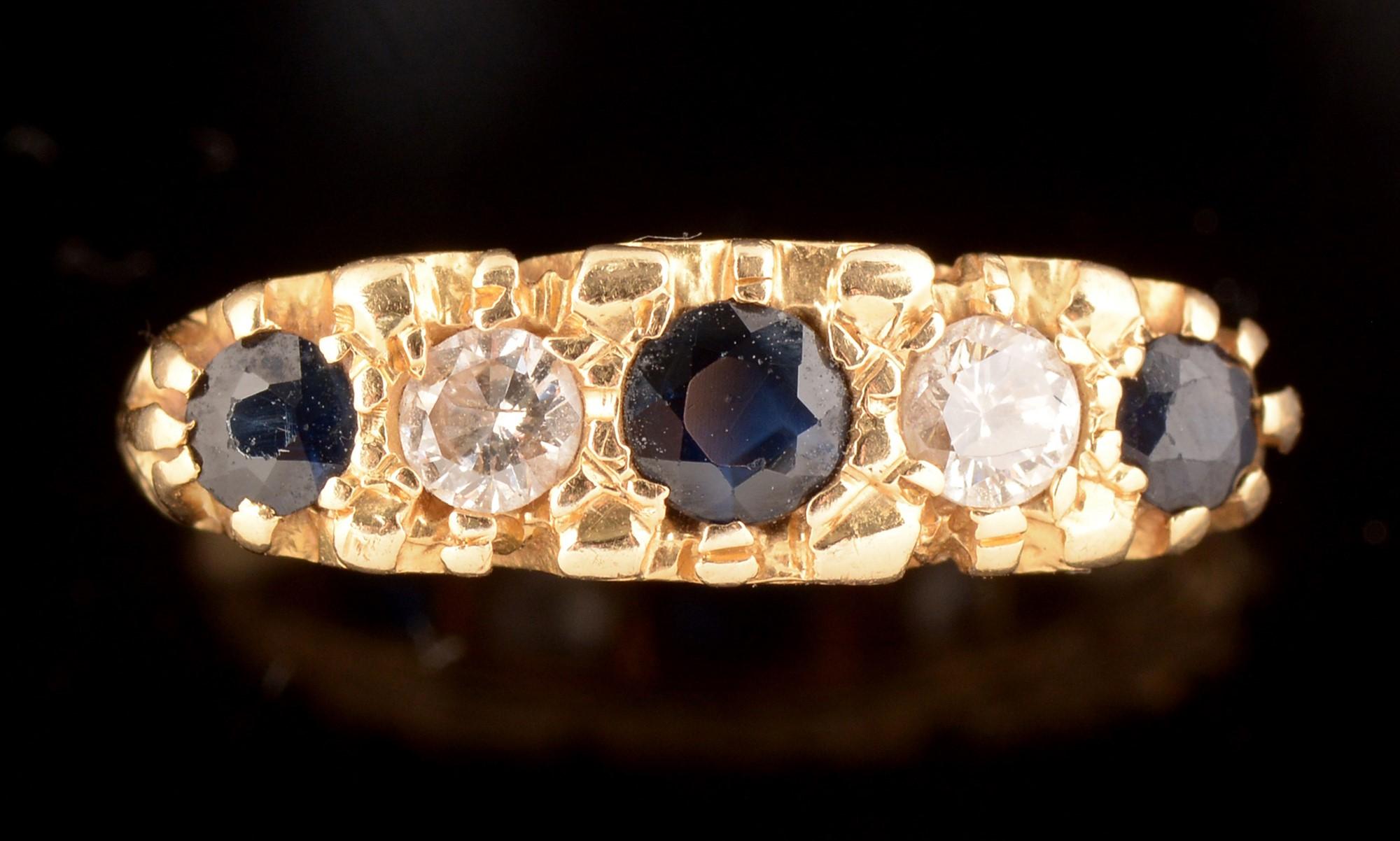 Lot 539 - Five stone sapphire and diamond ring