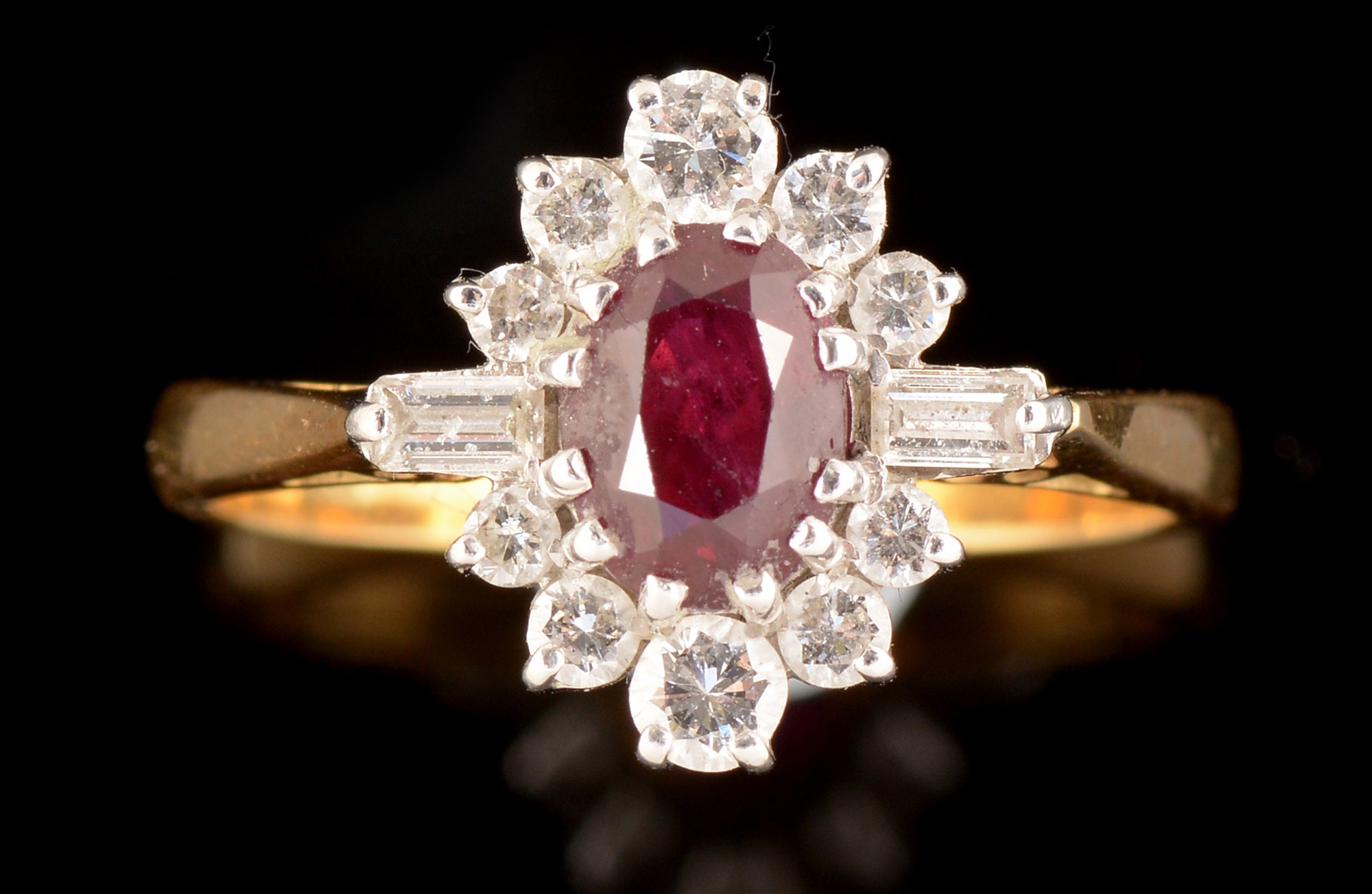 Lot 513 - Ruby and diamond ring