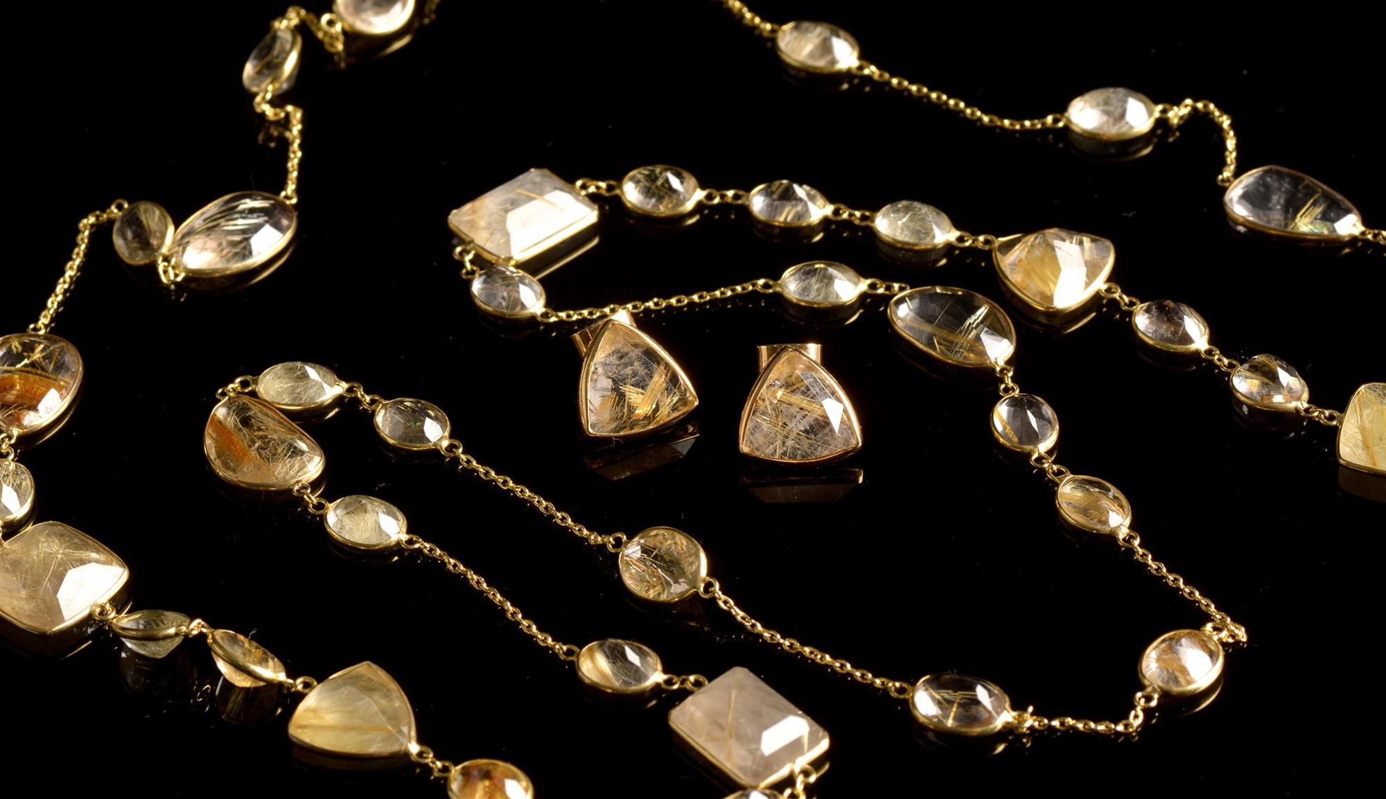 Lot 520 - Rutile quartz necklace and earrings