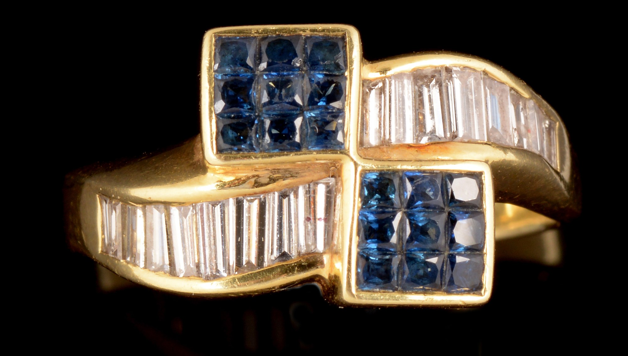 Lot 504 - Sapphire and diamond crossover ring