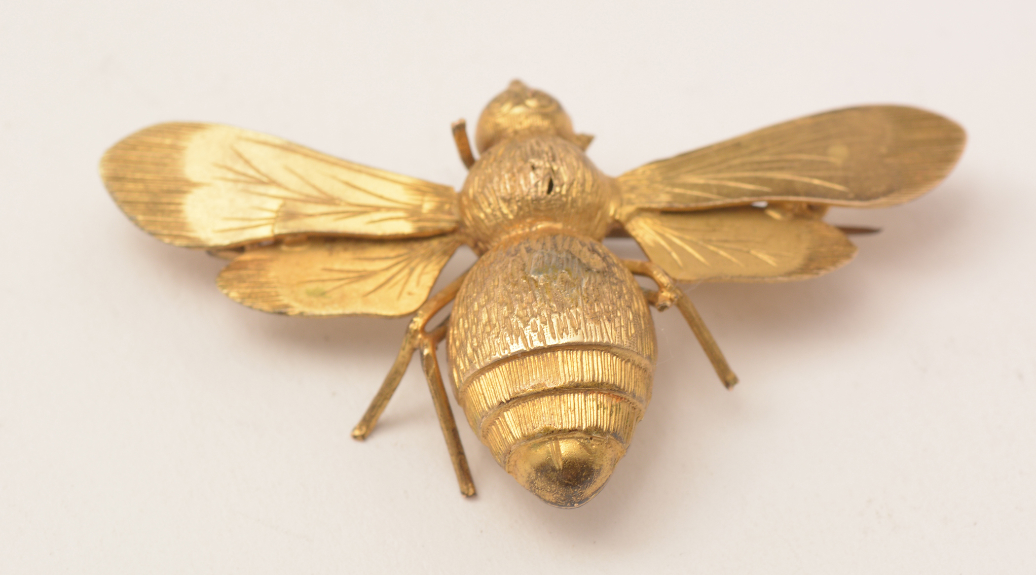 Lot 482 - Three gold bee brooches, boxed