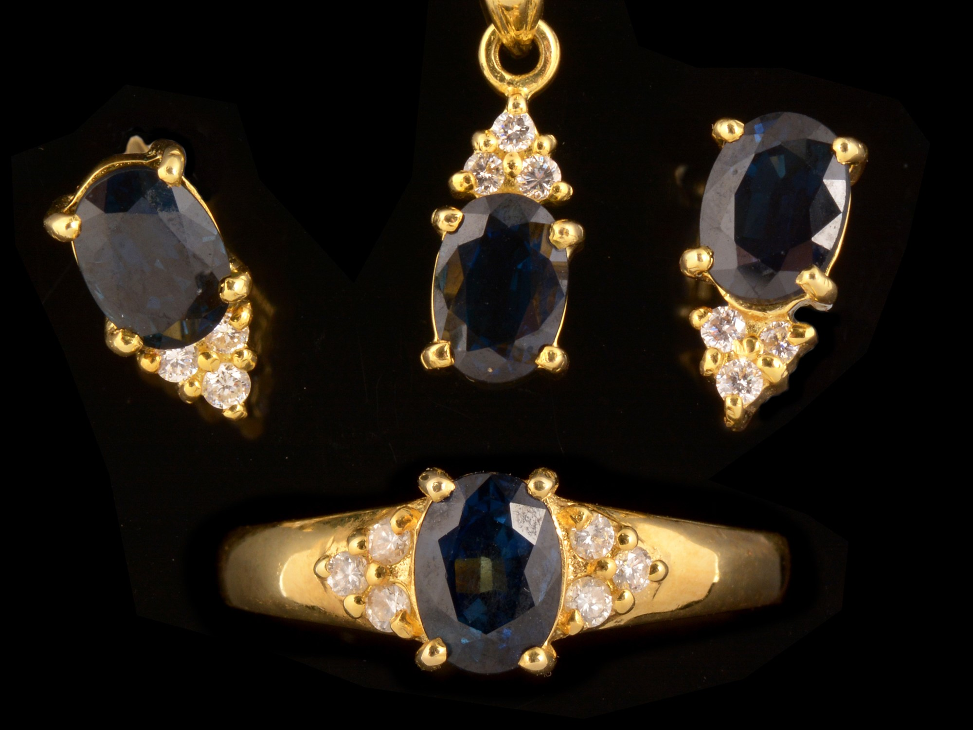 Lot 511 - Sapphire and diamond ring, earrings and pendant