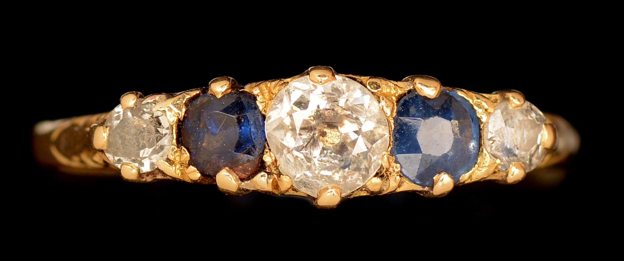 Lot 489 - Sapphire and diamond ring