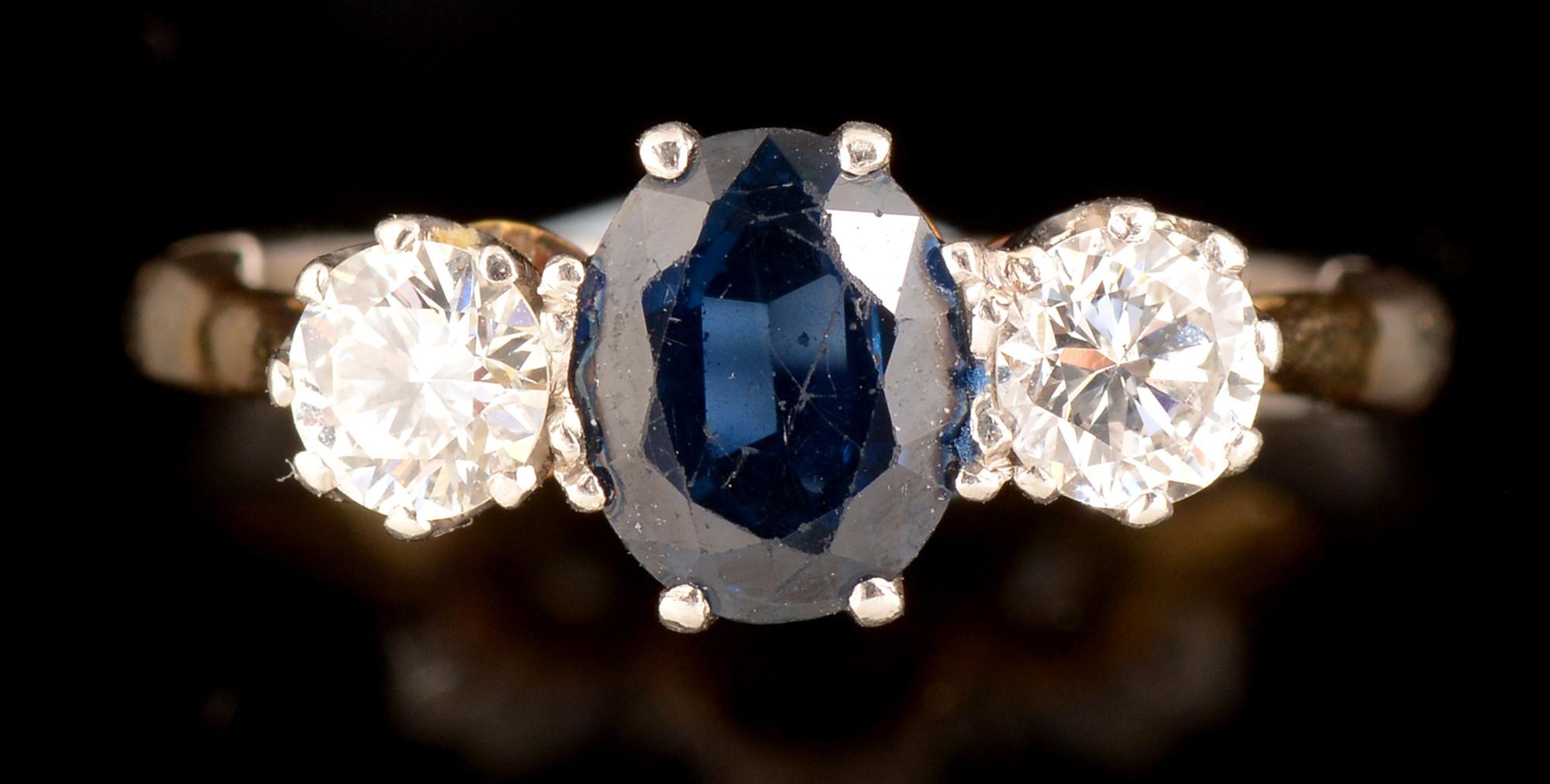 Lot 487 - Sapphire and diamond ring