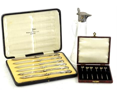 A cut glass whisky noggin, with silver plated mount, another set of six silver gilt cocktail sticks, each with a cockerel fin