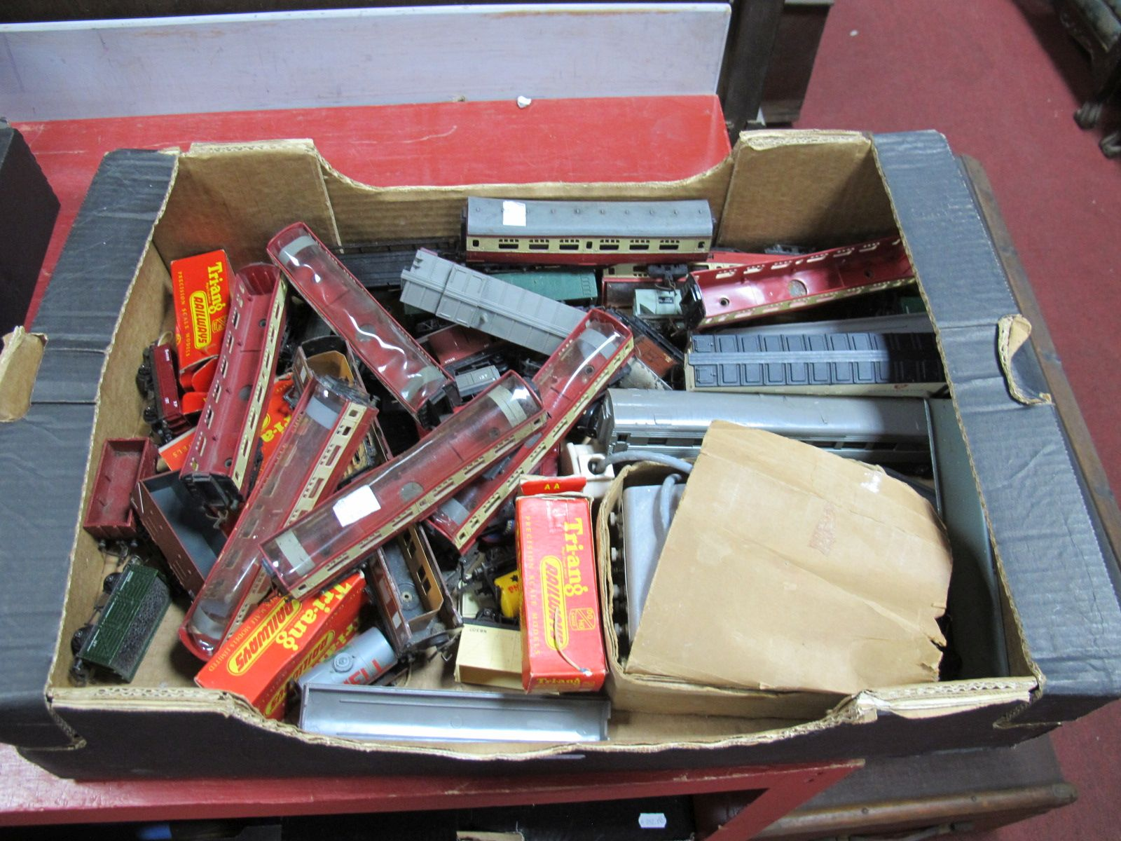 Lot 53 - A Box of Playworn Tri-ang 'OO' Gauge Railway Carriages and Goods Wagons.