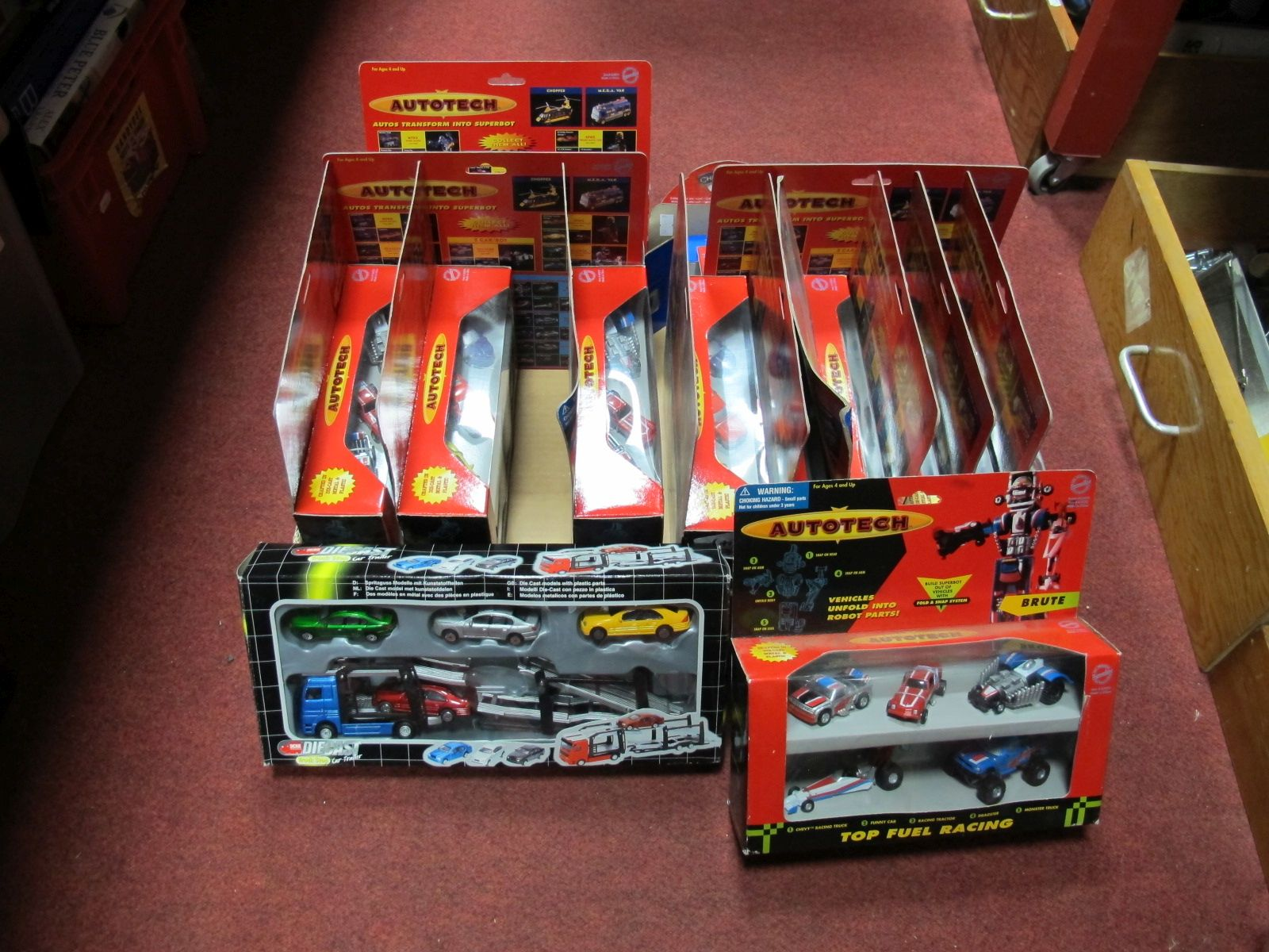 Lot 10 - Thirteen Boxed Auto Tech Cars, robot sets, together with boxed Hot Wheels Silver Anniversary set