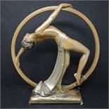 An Art Deco plaster figure of dancing girl, bearing impressed marks OP. 410, RD. 826323 to base, H.