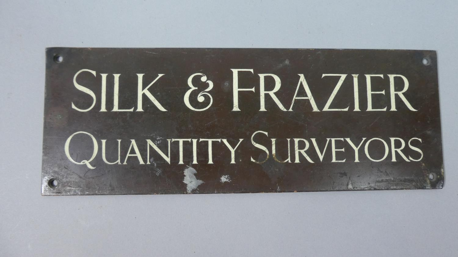 Lot 134 - An Edwardian Bronze Sign for Silk and Frazier, Quantity Surveyors, 28cm Wide