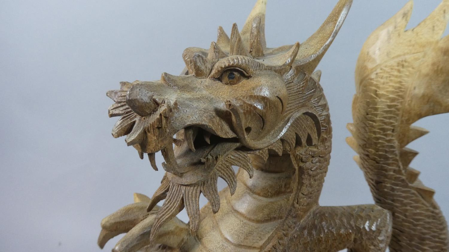 Lot 104 - A Large Modern Carved Wooden Study of a Dragon, 41.5cm High