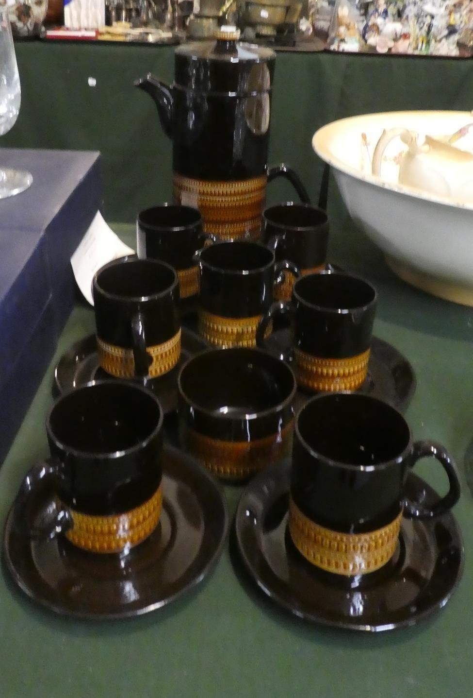 Lot 290 - A Treacle Glazed Coffee Set