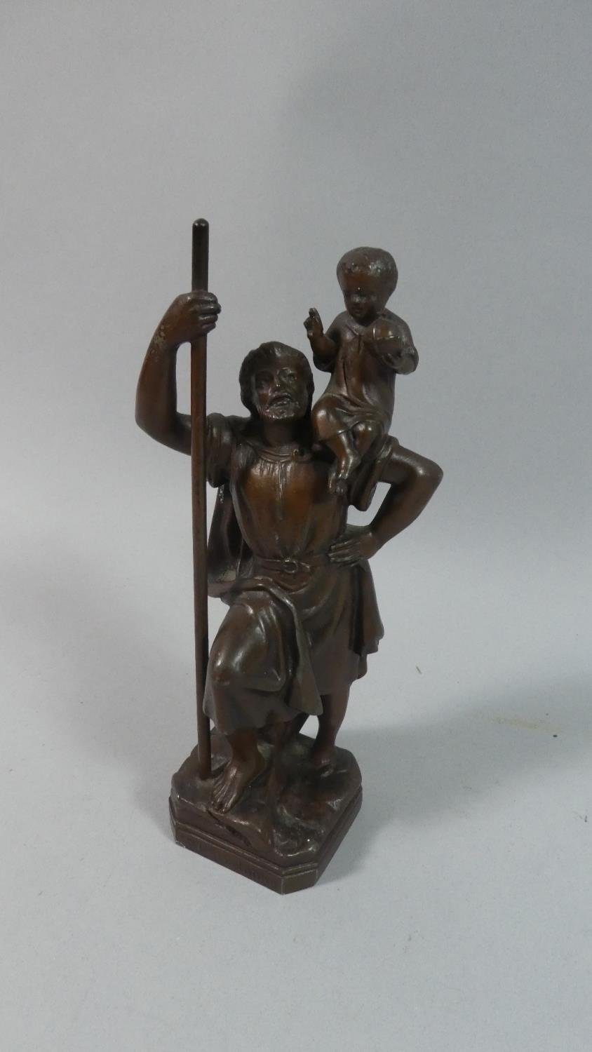 Lot 26 - A Bronze Figural Study of St. Christopher Carrying Jesus Holding Orb, 16.5cm high