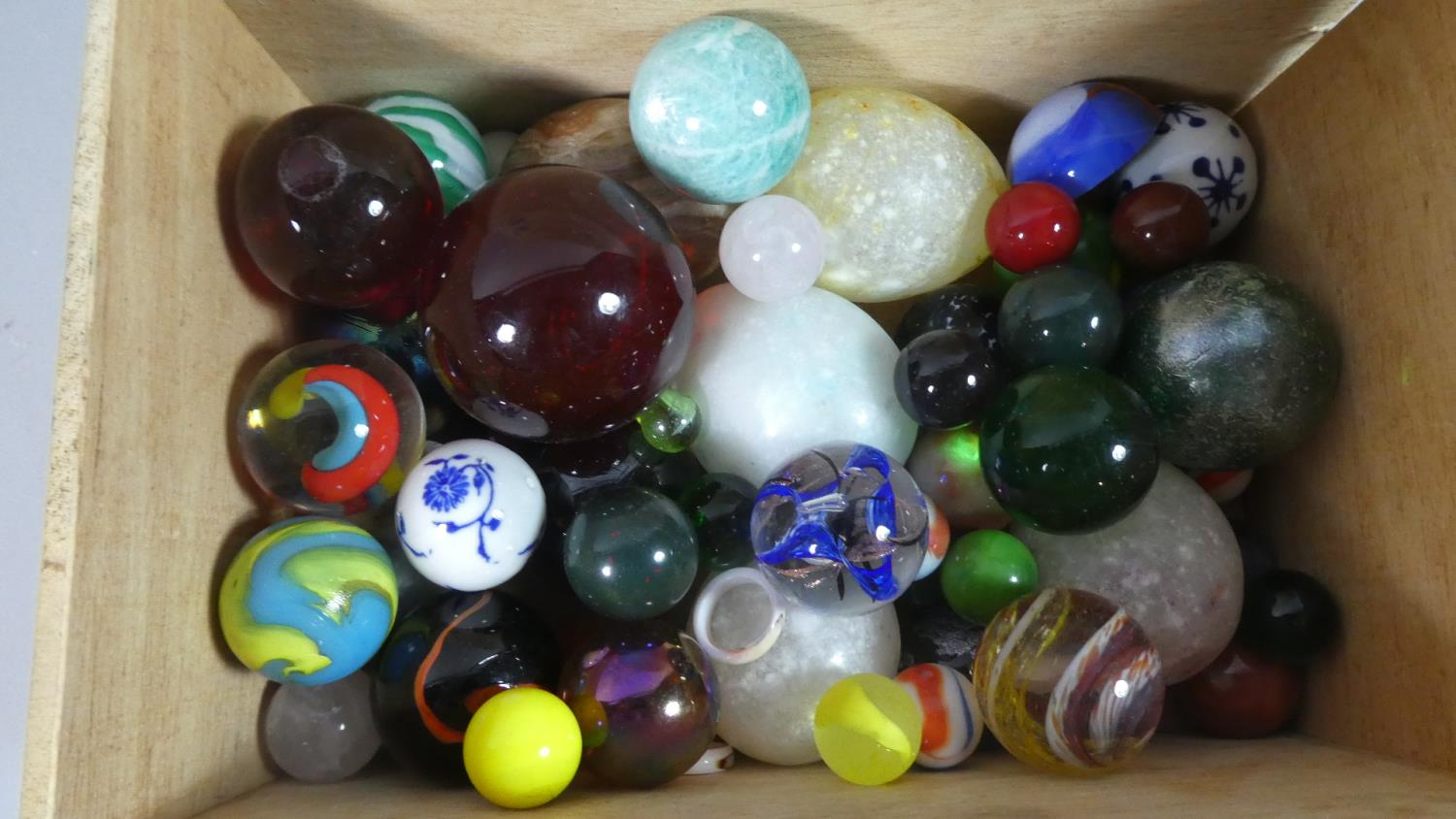 Lot 169 - A Collection of Various Coloured Glass Marbles, Stone Eggs etc