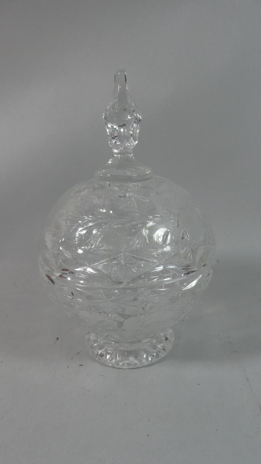 Lot 209 - A Globular Cut Glass Bowl with Cover with Etched Floral Decoration, 27cm