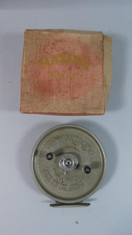 Lot 114 - A Vintage Maxima Dual Duty Fishing Reel in Original Cardboard Box, 14cm Diameter