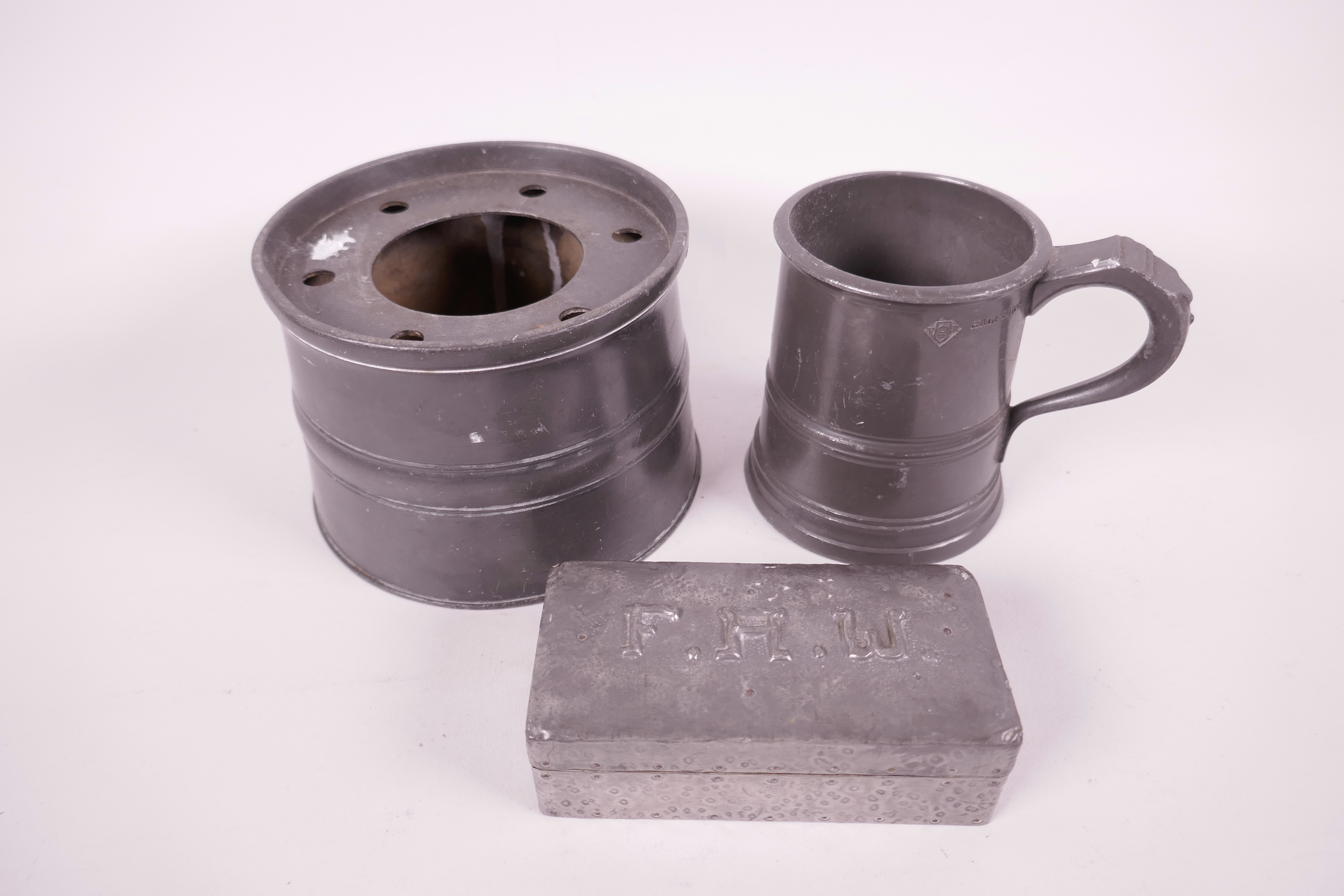 "Lot 429 - A C19th pewter inkwell, 4½"" diameter, a Victorian half pint tankard, and a pewter stamp box"