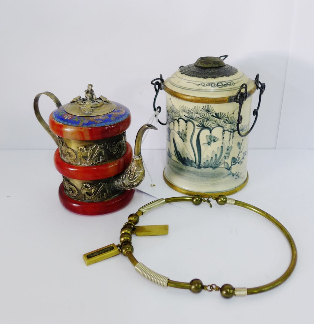 Lot 337 - Cambodian blue and white opium pipe, together with an Eastern white metal wine pot and a brass