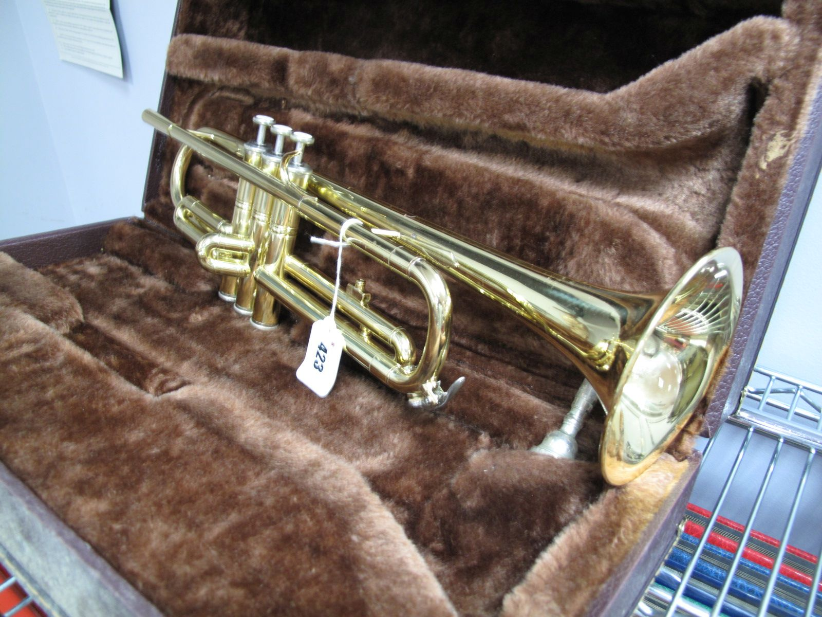 A Cased Elkhart Series II Trumpet