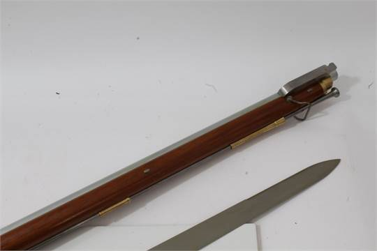 Replica Baker flintlock rifle with steel ramrod, walnut stock and