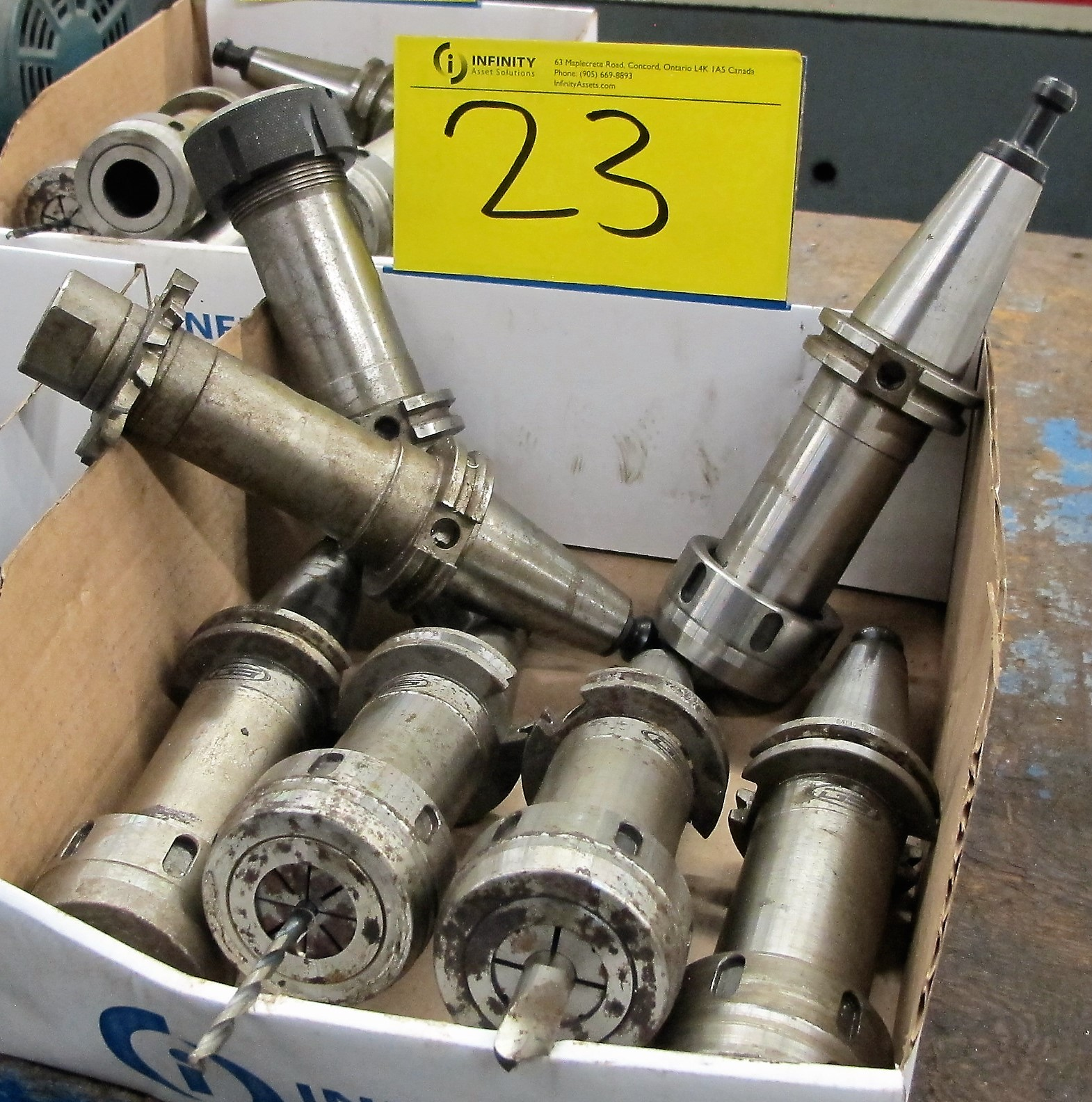 LOT OF 7 CAT40 TOOL HOLDERS W/ATTACHMENTS