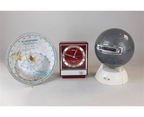 A radio in the form of the moon, a red plastic mantle clock and a planisphere dish (a/f), (SPM)