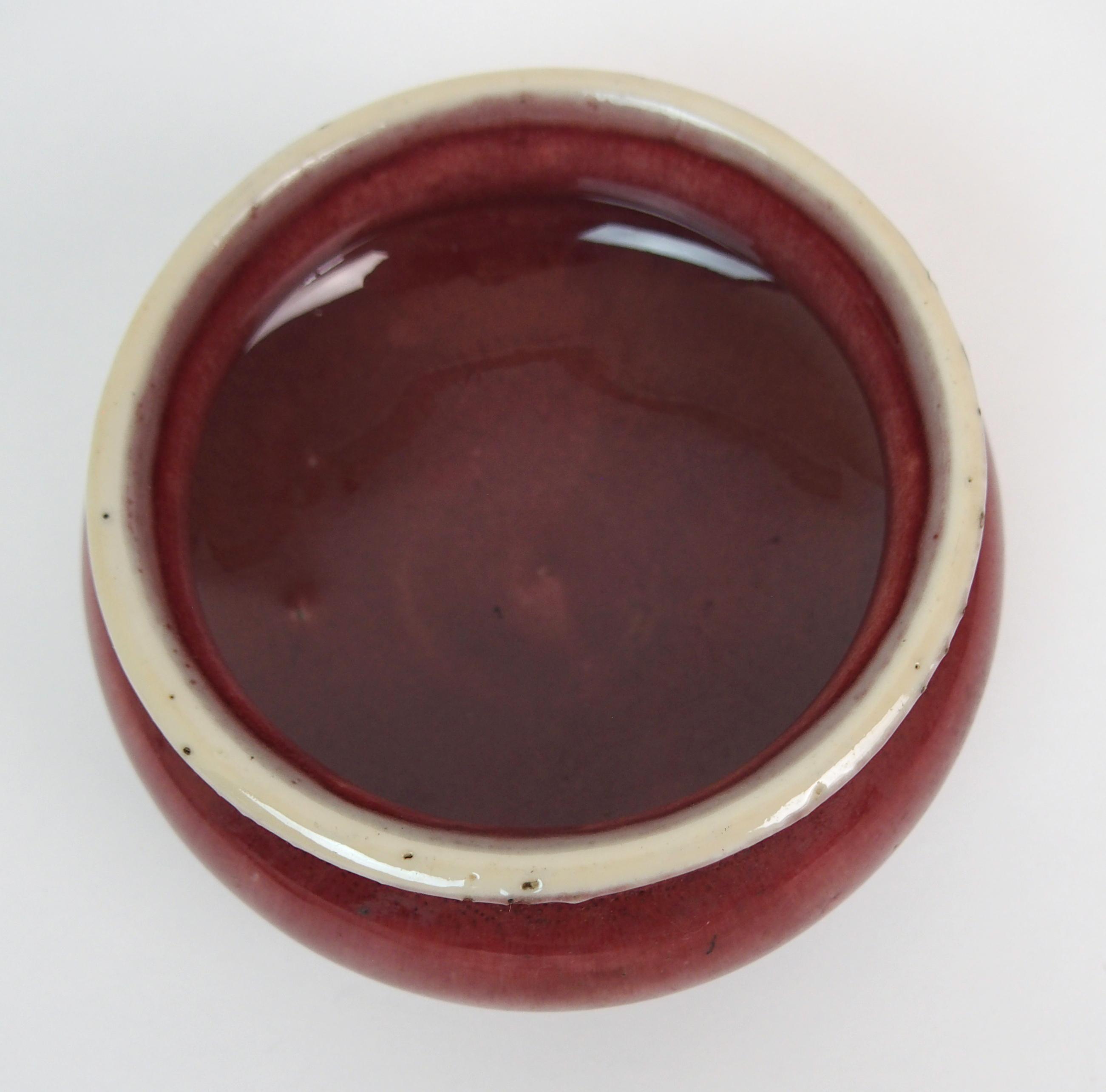 Lot 13 - A CHINESE MONOCHROME CENSER on tripod bases, 11cm diameter, blue and white saucer, 18cm diameter,