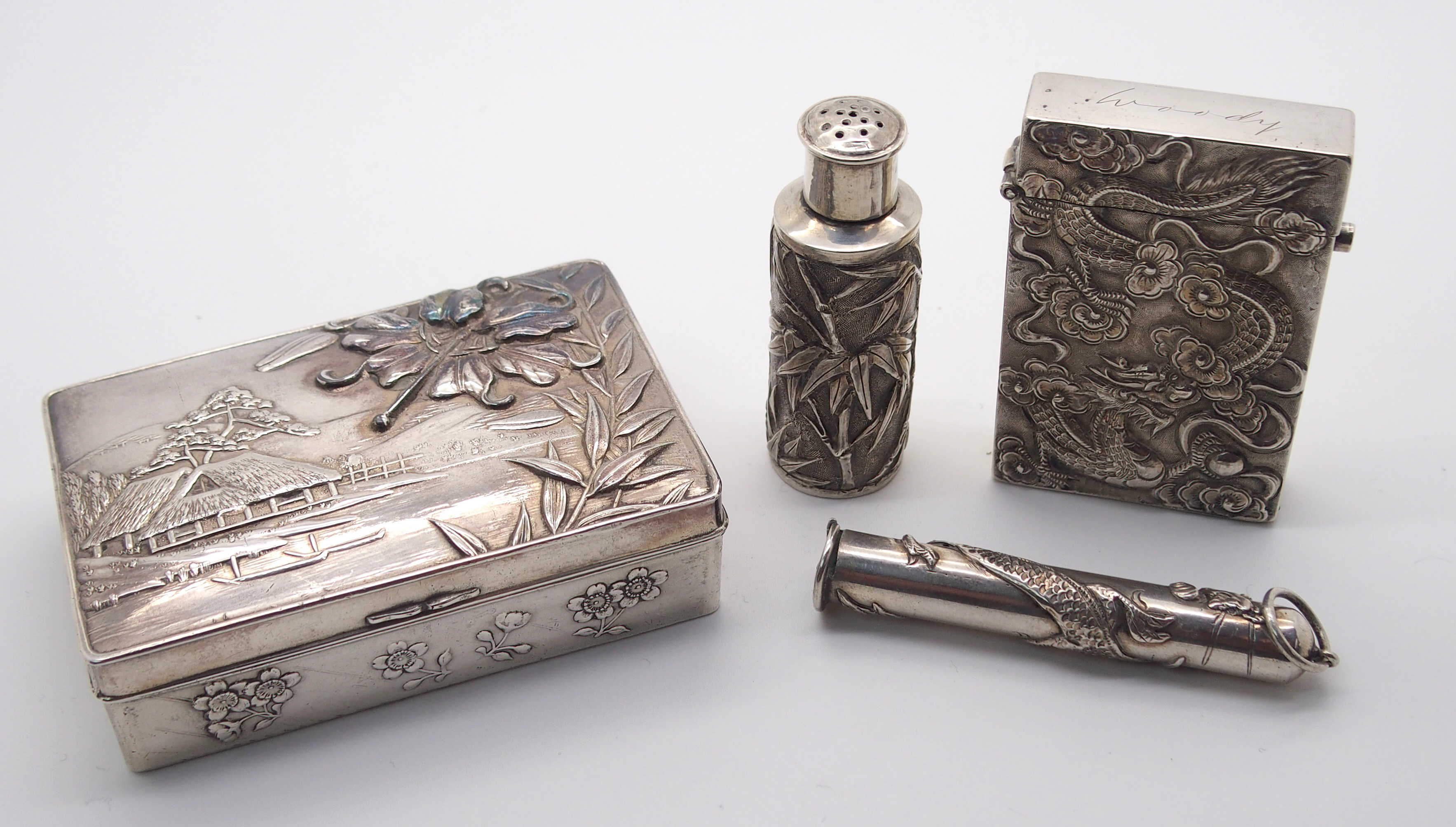 Lot 6 - A CHINESE SILVER PEPPER CASTOR decorated with bamboo, stamped WH 90, 5.5cm high, white metal