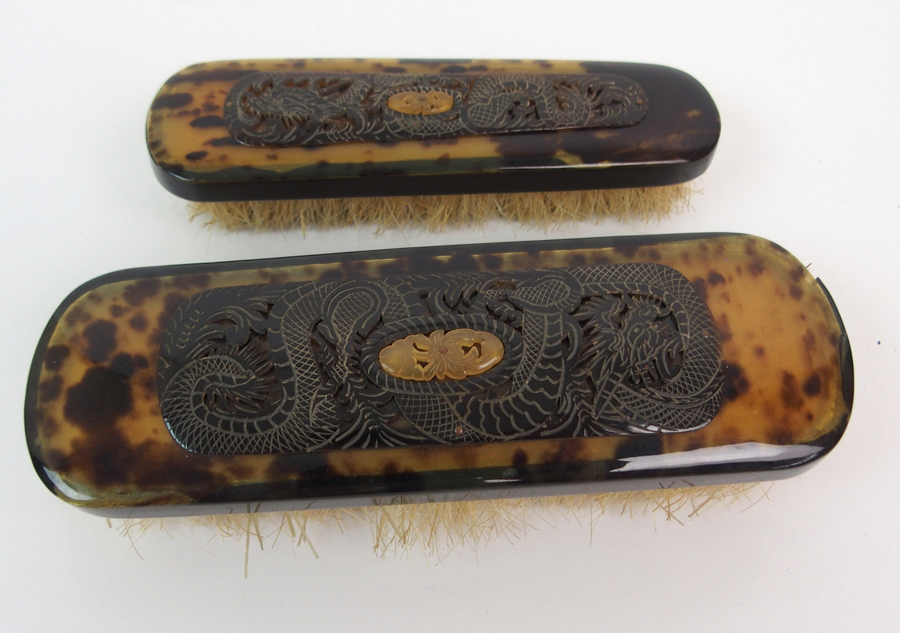 Lot 10 - A CHINESE TORTOISESHELL BRUSH SET comprising; hand mirror, clothes brushes, hair brushes, button