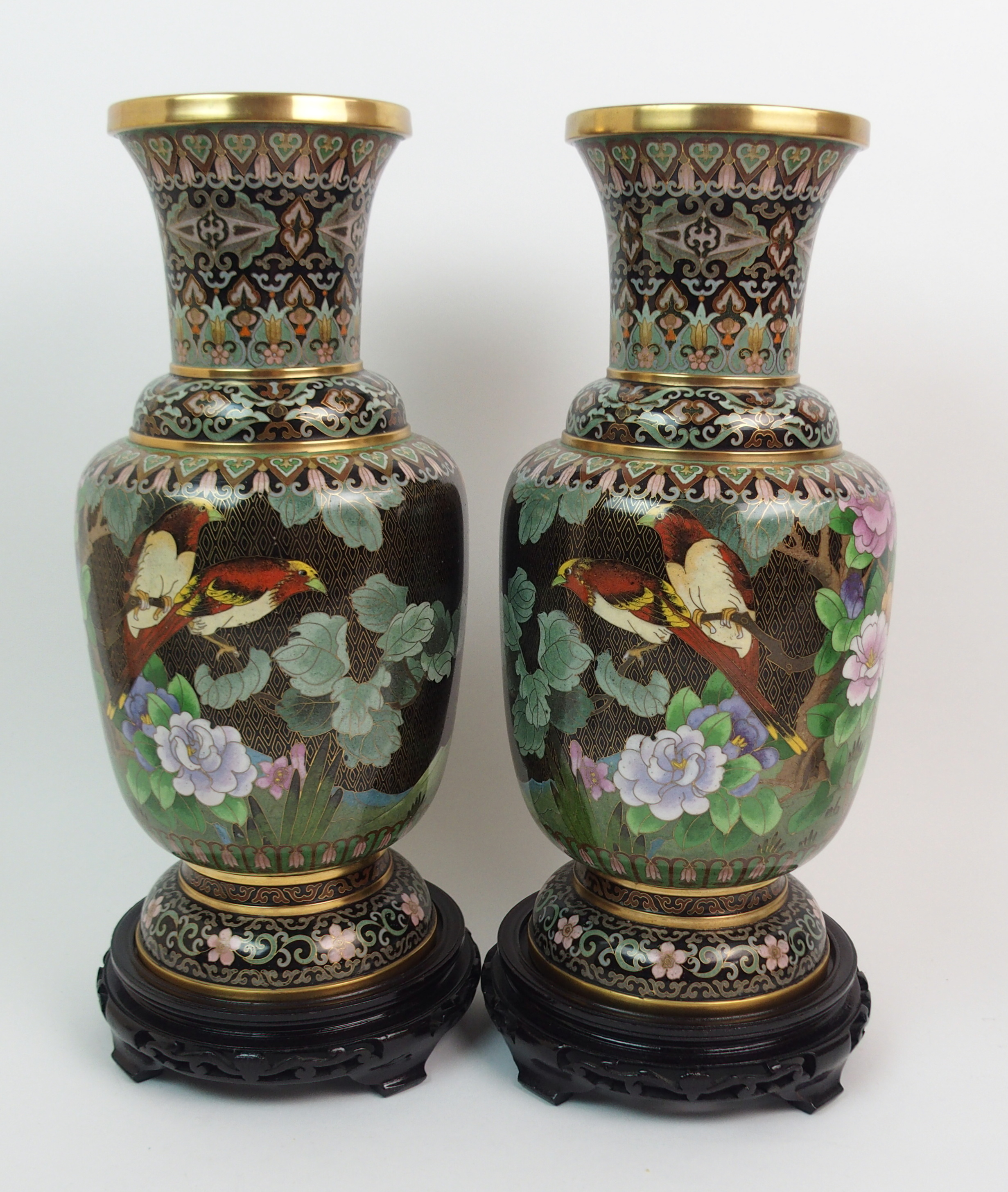 Lot 16 - A PAIR OF CHINESE CLOISONNE BALUSTER VASES decorated with flowers and diaper, wood stands, 38cm high