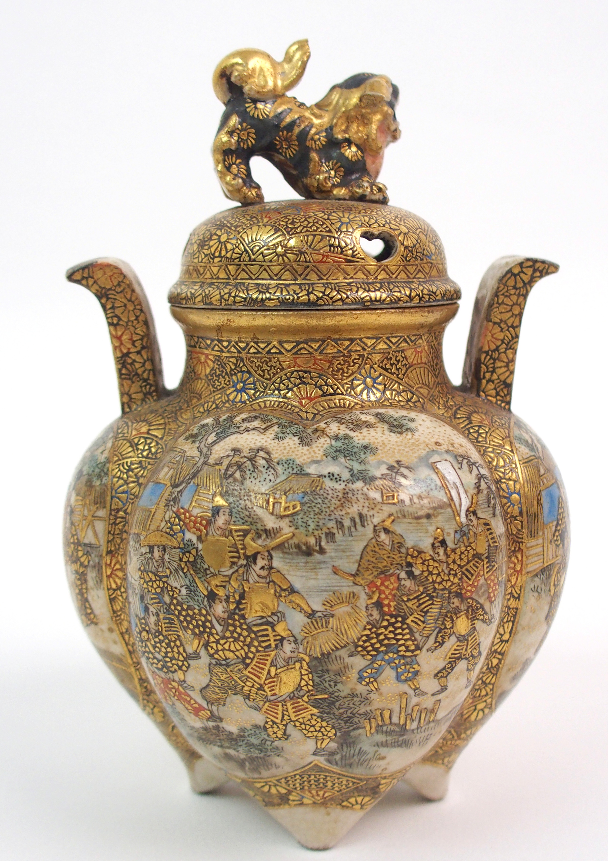 Lot 34 - A SATSUMA KORO the cover with shishi finial above a quatrefoil lobed body painted with numerous