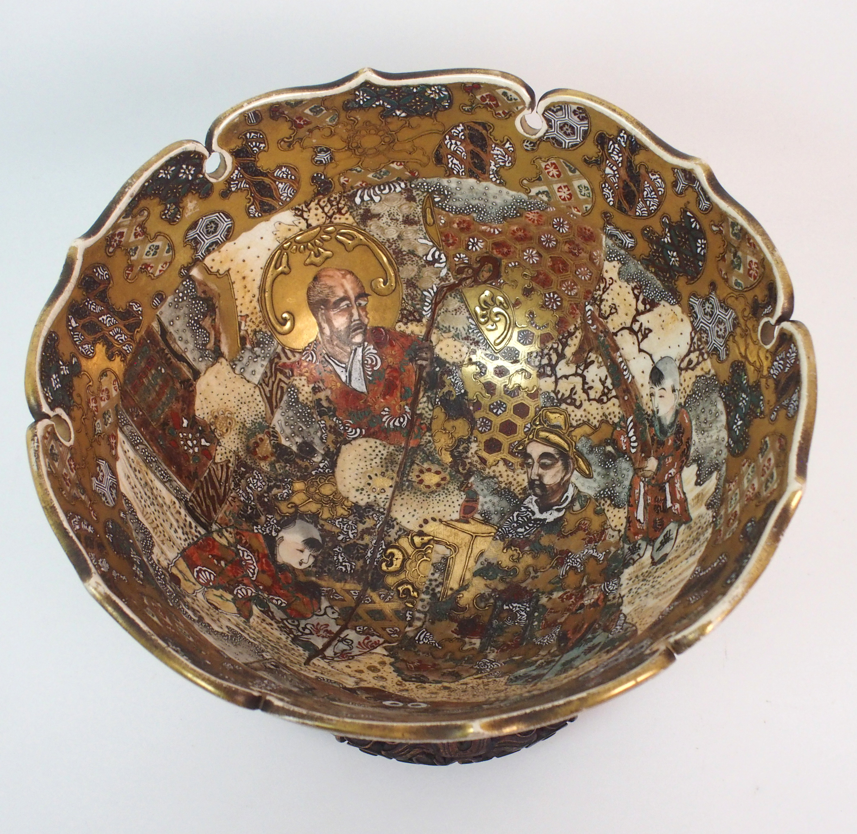 Lot 55 - A SATSUMA BOWL painted with figures in a garden within gilt brocade border and pierced foliate