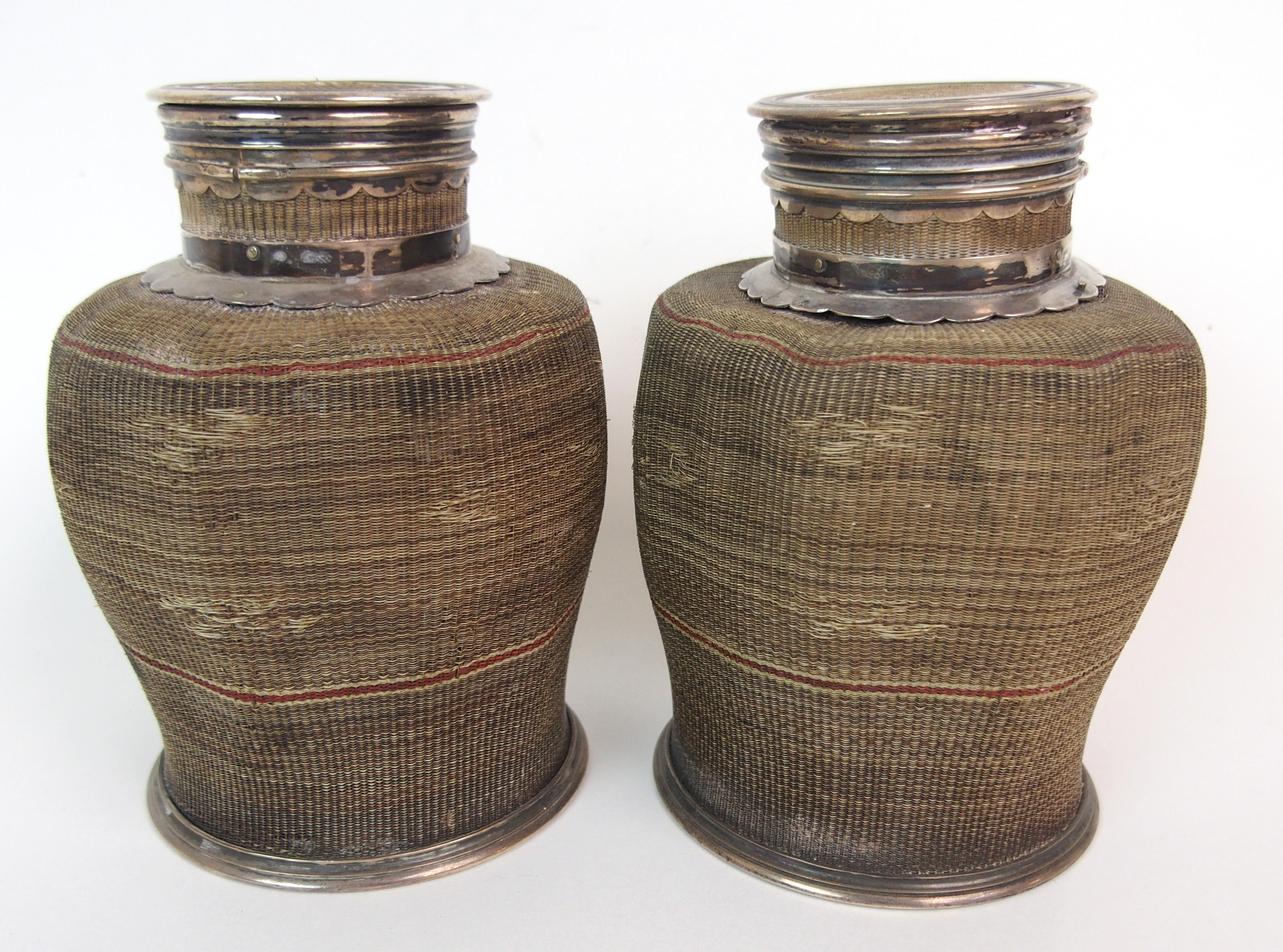 Lot 22 - A PAIR OF CHINESE WHITE METAL AND WOVEN TEA CADDIES the decagonal bound bodies with circular