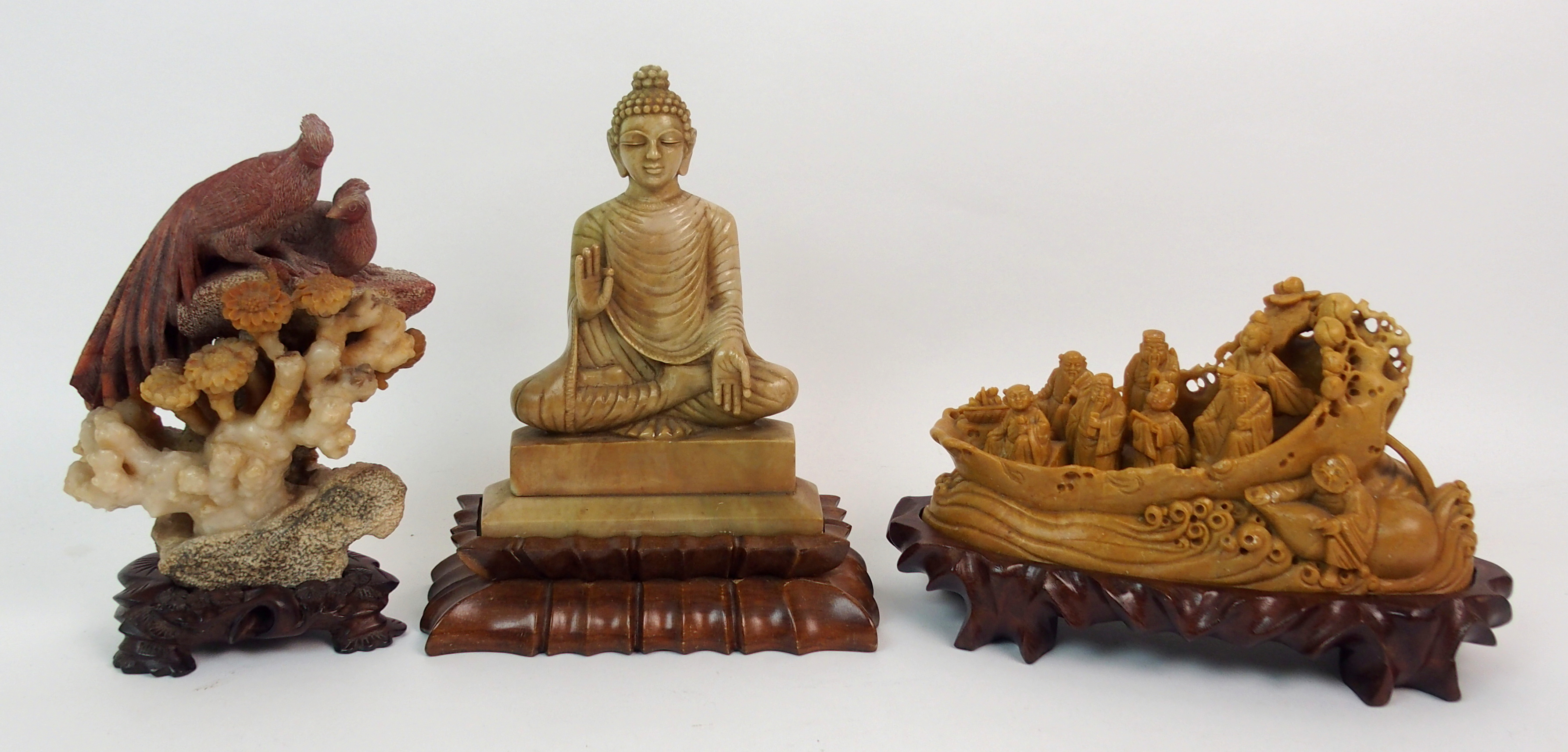 Lot 59 - A CHINESE SOAPSTONE CARVING OF BUDDHA 17.5cm high, wood stand, peacock and hen on rockwork, 17cm