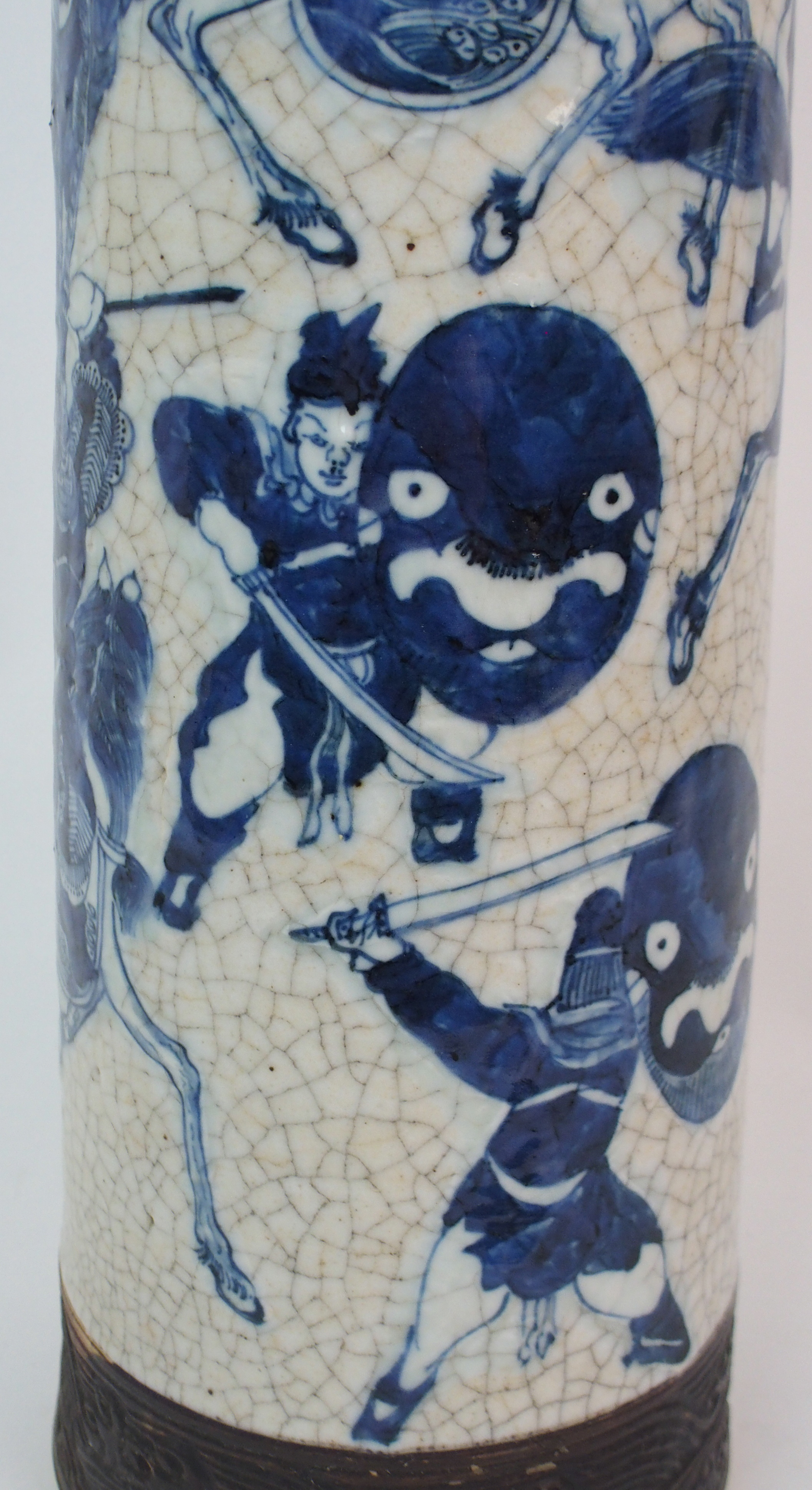 Lot 27 - A CHINESE CRACKLEWARE RELIEF MOULDED VASE painted with warriors within bronzed coloured bands,