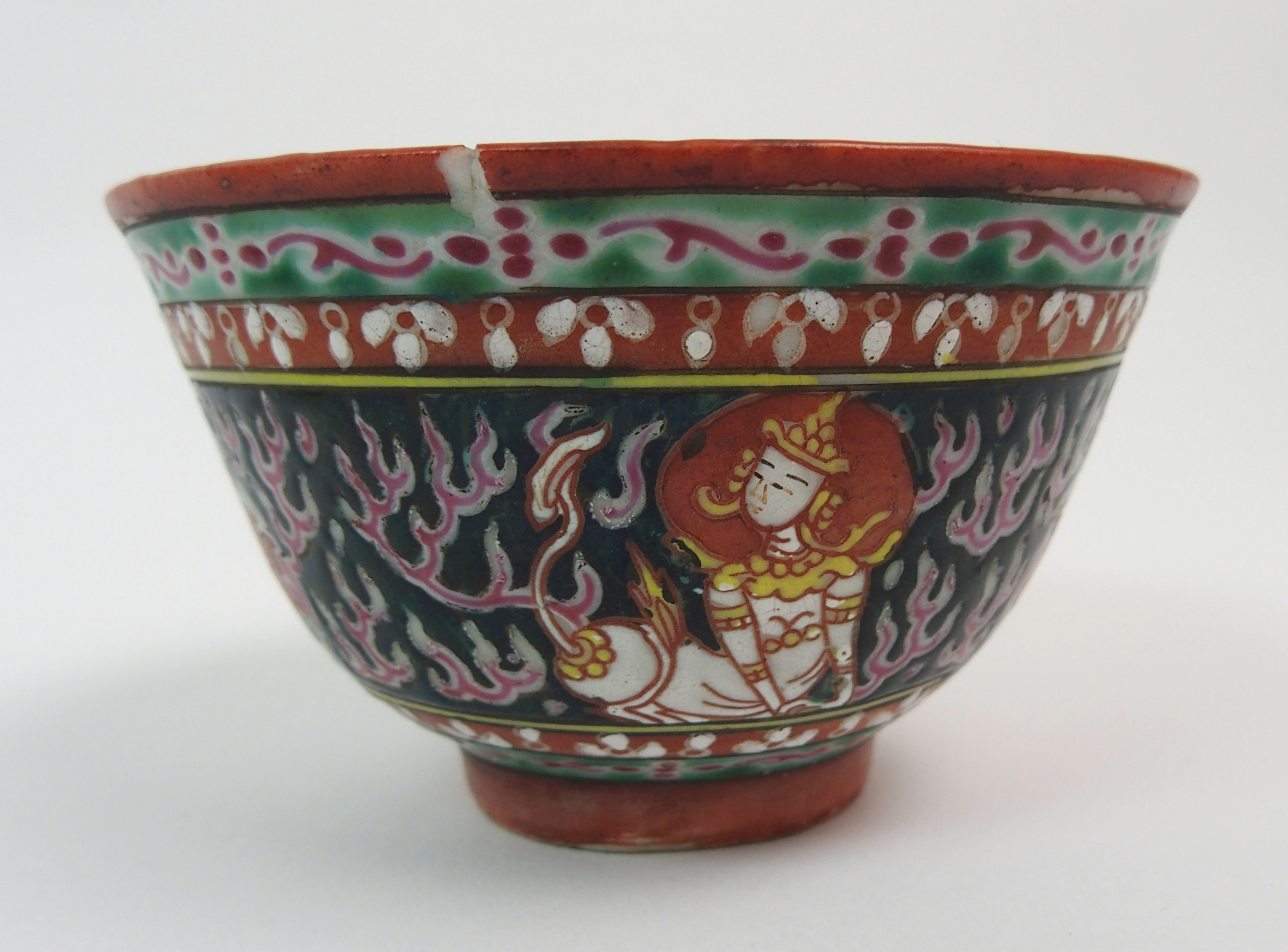 Lot 38 - A CHINESE EXPORT BOWL made for the Indian market painted with alternative deities on a black and