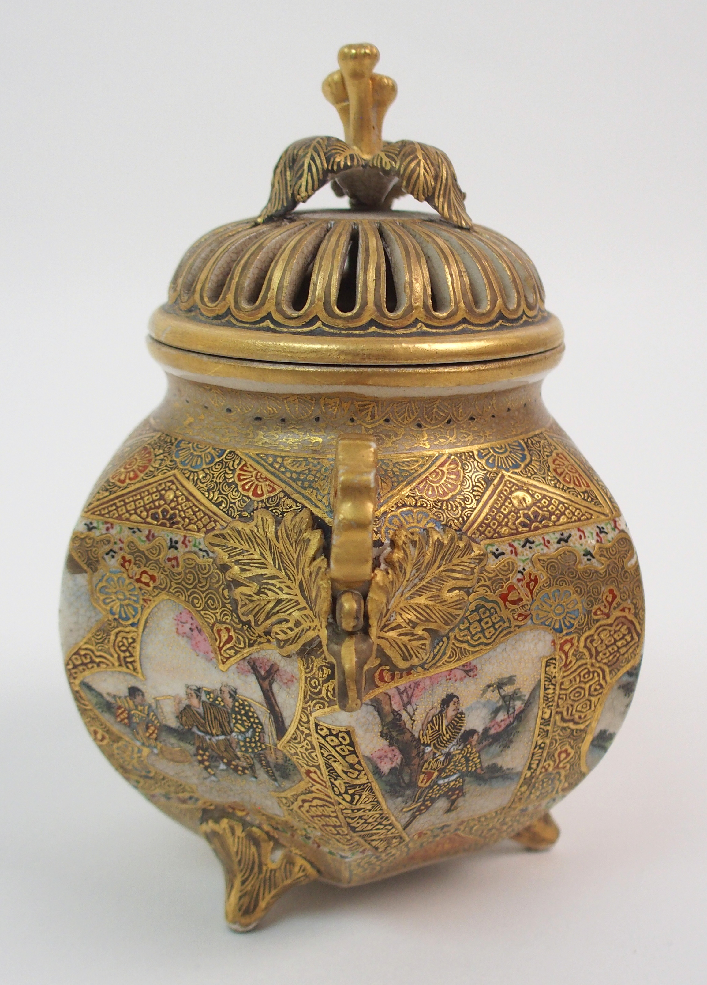 Lot 35 - A SATSUMA KORO the pierced flower form cover with foliate knop above a hexagonal body painted with