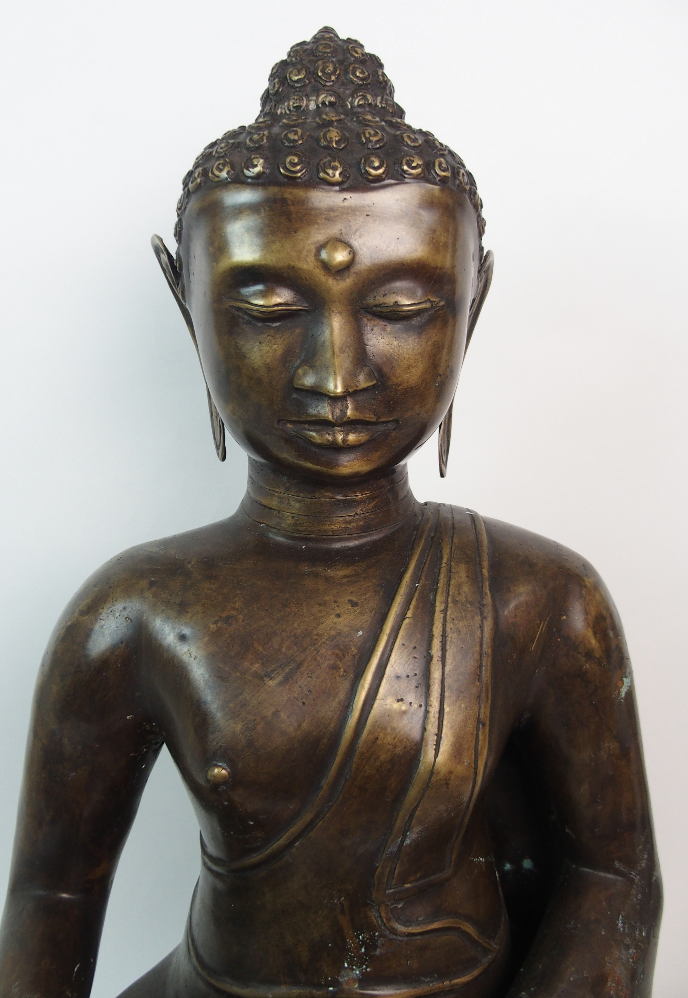 Lot 51 - A BRONZED MODEL OF BUDDHA of traditional type, seated on a high lotus throne, 62cm high and