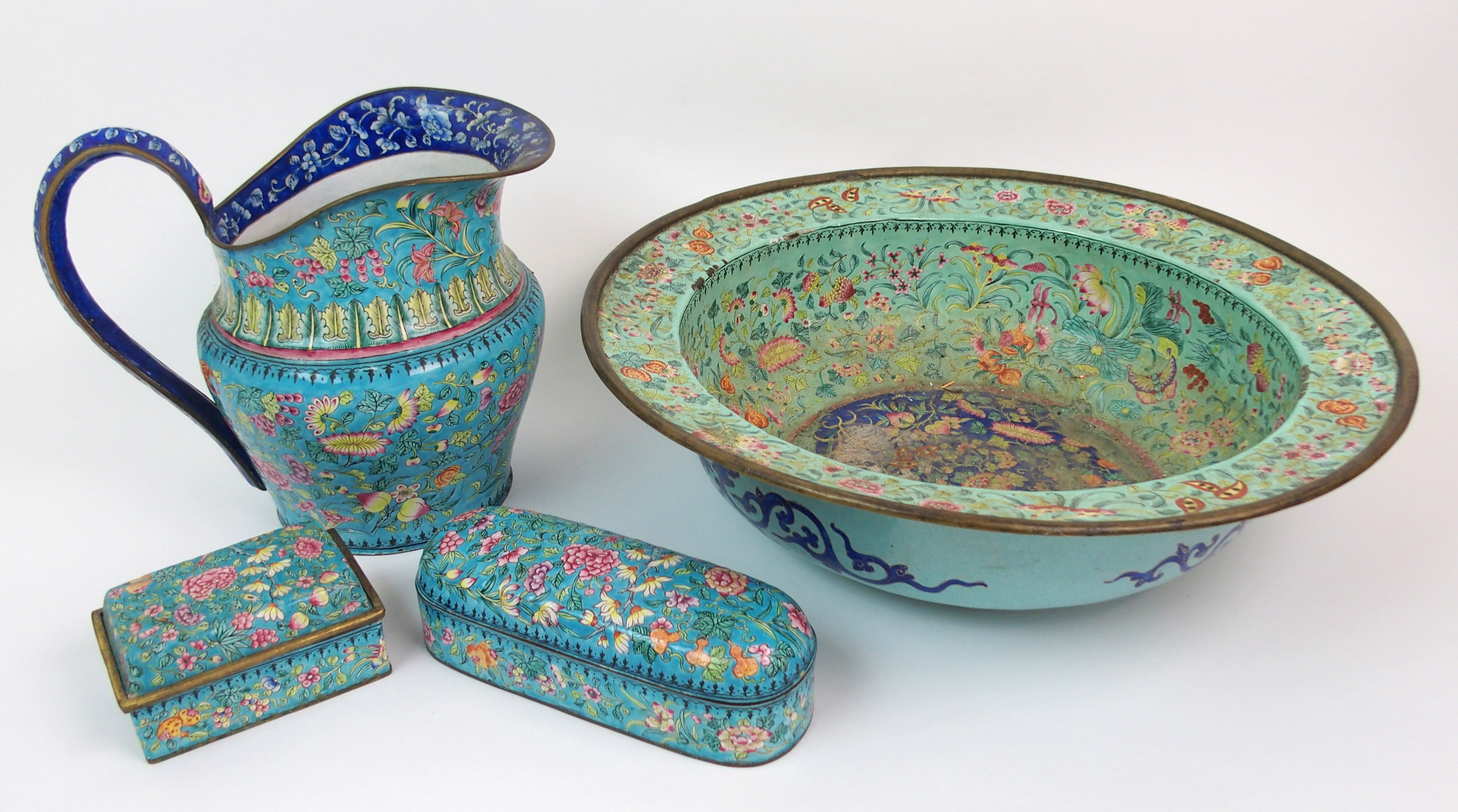 Lot 5 - A CANTONESE ENAMEL WASH BASIN painted allover with fruit and flowers (damages), 42.5cm diameter,